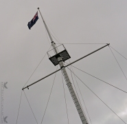 New Zealand Flag on Old Ship Mast at Flagstaff Lookout, Port Chalmers, Dunedin, New Zealand.